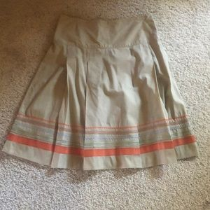 Woven skirt with fun trim detail and side zipper